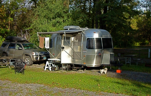 My 2004 Airstream Bambi named Winnie with Max the Maltese added for scale.