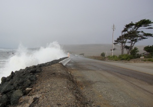 Waves crashing over Route 1.